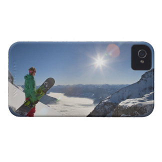 Snowboarder looking from mountain top iPhone 4 cases