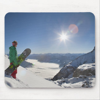 Snowboarder looking from mountain top mouse mat