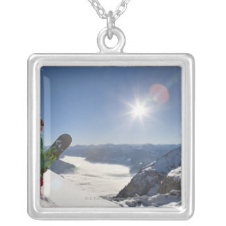 Snowboarder looking from mountain top silver plated necklace