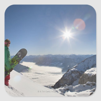 Snowboarder looking from mountain top square sticker