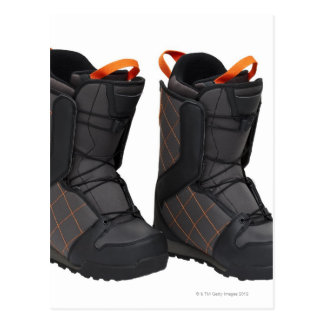 Snowboarding boots on white background, cut out postcard