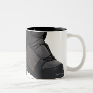 Snowboarding boots on white background, cut out Two-Tone coffee mug