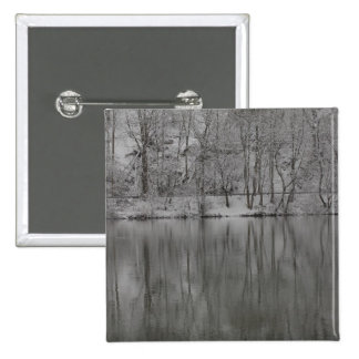 snowed trees reflected by the river 15 cm square badge