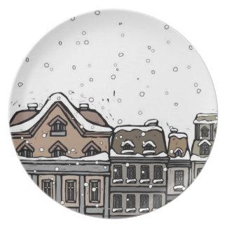 Snowfall over a city plate
