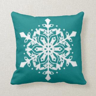 snowflake on teal throw pillow