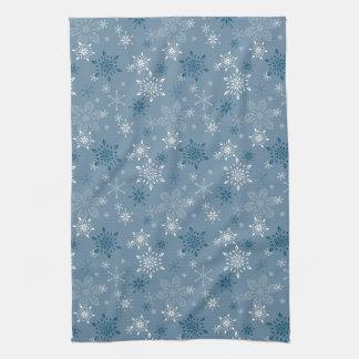 Snowflakes on a blue background tea towel