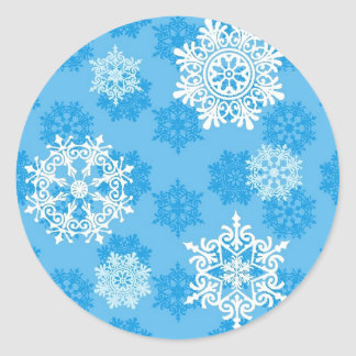Snowflakes on Blue Background Classic Round Sticker