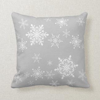 snowflakes on grey cushion
