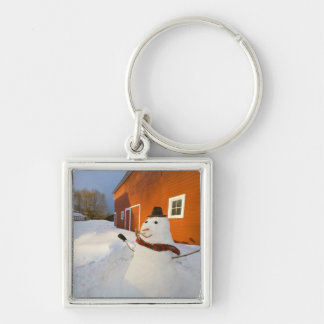 Snowman in front of red barn in Columbia Falls Key Ring