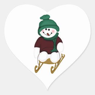 Snowman on a Sled Heart Sticker