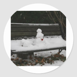 Snowman on the bench classic round sticker