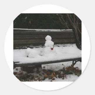 Snowman on the bench round sticker