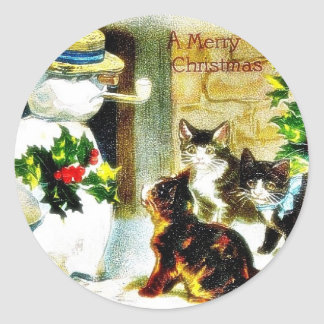 Snowman standing with holy leaves and cats around classic round sticker