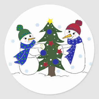 Snowmen Decorating a Christmas Tree Round Stickers