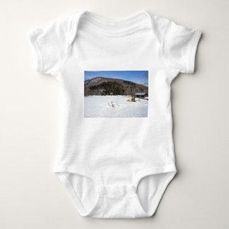 Snowmen in a field baby bodysuit