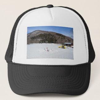 Snowmen in a field trucker hat