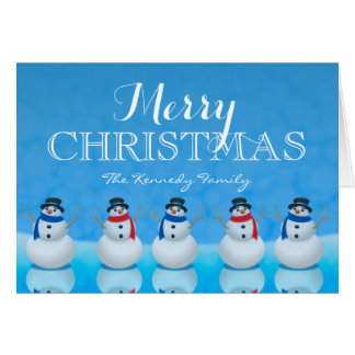 Snowmen in row against blue background greeting card