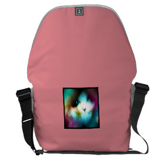 snowshoe kitty surrounded by rainbow messenger bags