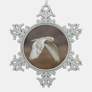 Snowy owl in flight snowflake pewter christmas ornament