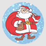 Snowy Santa and his big bag of gifts Round Sticker