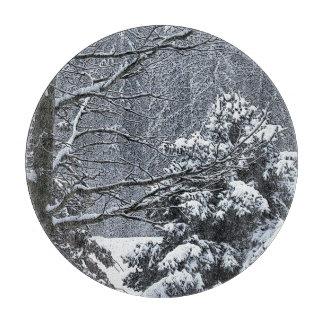 Snowy trees winter wonderland cutting board