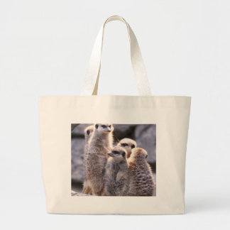 snuggling family meerkats tote bags
