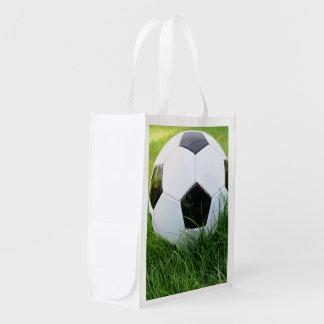 Soccer Ball in the Summer Grass