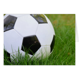 Soccer Ball in the Summer Grass Greeting Card