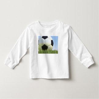 Soccer ball on grass. t shirt