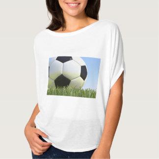 Soccer ball on grass. T-Shirt