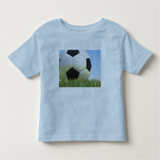 Soccer ball on grass. tshirt