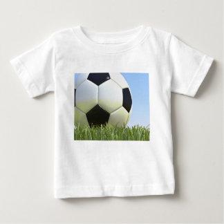 Soccer ball on grass. tshirts