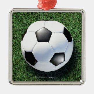 Soccer ball on green grass, close-up christmas ornament