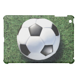 Soccer ball on green grass, close-up iPad mini cover