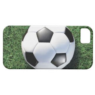 Soccer ball on green grass, close-up iPhone 5 cover