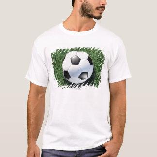 Soccer ball on green grass, close-up T-Shirt