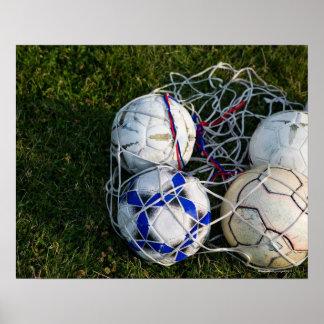 Soccer balls in net poster