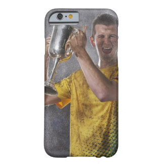 Soccer captain holding up trophy cup on field barely there iPhone 6 case