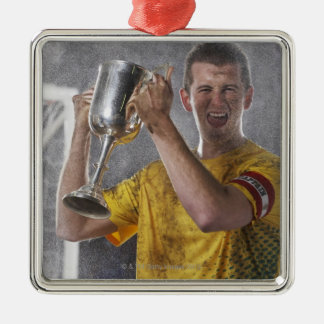 Soccer captain holding up trophy cup on field Silver-Colored square decoration