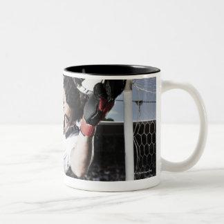 Soccer goalie catching soccer ball Two-Tone coffee mug