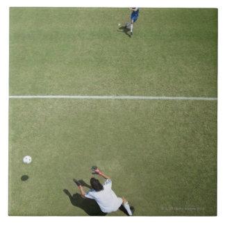 Soccer goalie missing soccer ball 2 large square tile