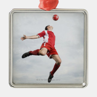 Soccer player and soccer ball in mid-air christmas ornament
