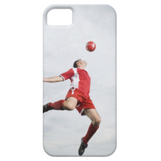 Soccer player and soccer ball in mid-air iPhone 5 case