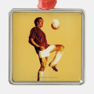 soccer player bouncing ball off knee christmas ornament