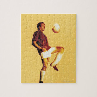soccer player bouncing ball off knee jigsaw puzzle