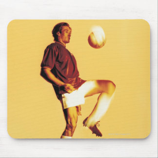 soccer player bouncing ball off knee mouse pad