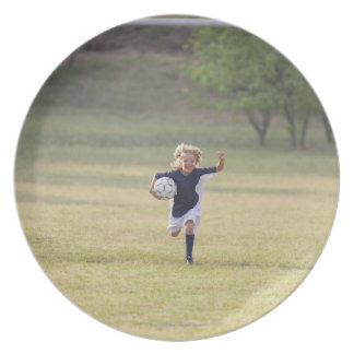Soccer player cheering and yelling dinner plates