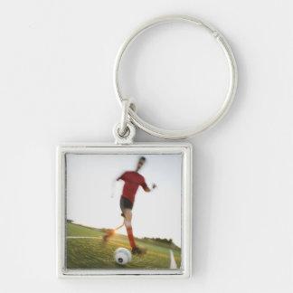 Soccer player dribbling ball key ring