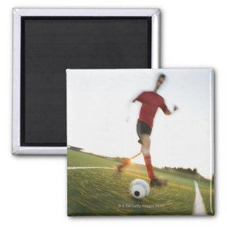 Soccer player dribbling ball magnet