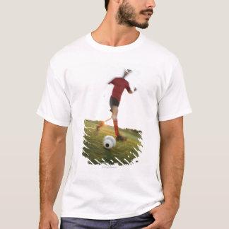 Soccer player dribbling ball T-Shirt